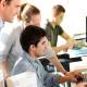 Students with teacher in front of desktop computer; Shutterstock ID 96602677; PO: Shutterstock; Job: Shutterstock Groupon global relicense 5000